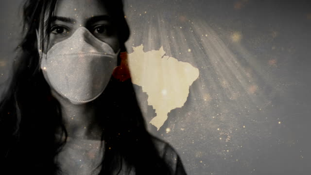 coronavirus 2019-ncov novel coronavirus concept motion background, patience with protective mask and brazil map overlay. - america latina video stock e b–roll