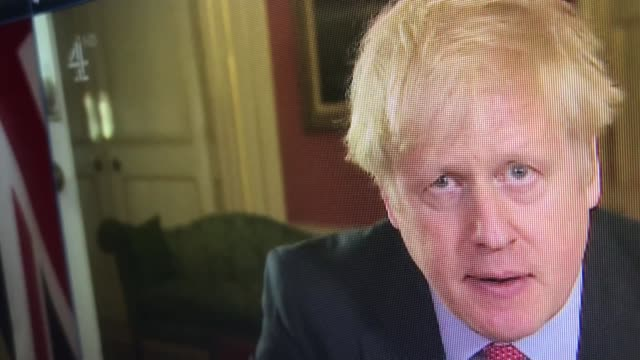 stockvideo's en b-roll-footage met volunteers sought for nhs as uk sees highest virus deaths in a day; england: int various shots of screens showing boris johnson mp statement from... - channel 4 news