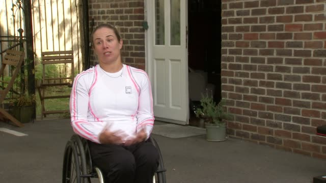 """challenge"""" raises funds for charities following london marathon postponement; england: ext lucy shuker setup shots as bouncing ball off side of house... - tennis racket stock videos & royalty-free footage"""