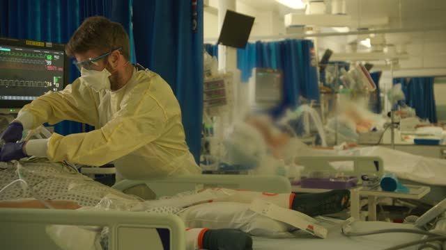 covid patients being treated at st george's hospital icu; england: london: tooting: st george's hospital: int patient on a ventilator on the... - patient stock videos & royalty-free footage