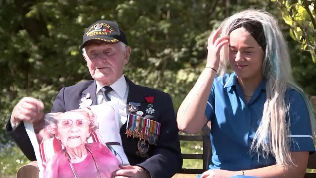 year-old d-day veteran given cushion with his late wife's picture on it by his teenage carer; england: lancashire: preston: thistleton lodge care... - cushion stock videos & royalty-free footage