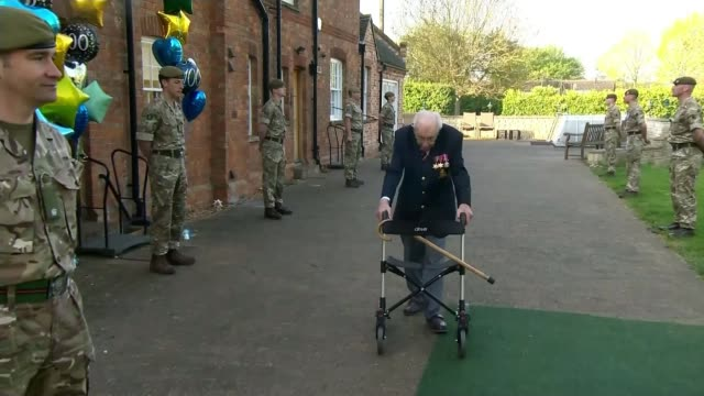 99yearold wwii veteran captain tom moore raises £15m for nhs charities england bedfordshire marston moretaine ext captain tom moore along past guard... - captain tom moore stock videos & royalty-free footage