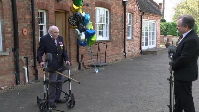 99yearold wwii veteran captain tom moore raises £15m for nhs charities england bedfordshire marston moretaine ext reporter to camera captain tom... - captain tom moore stock videos & royalty-free footage