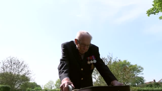 99yearold wwii veteran captain tom moore raises £15m for nhs charities england bedfordshire ext various captain tom moore walking in garden captain... - captain tom moore stock videos & royalty-free footage