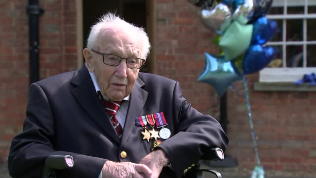 99yearold wwii veteran captain tom moore raises £15m for nhs charities england bedfordshire ext captain tom moore set up shots / interview sot gvs... - captain tom moore stock videos & royalty-free footage