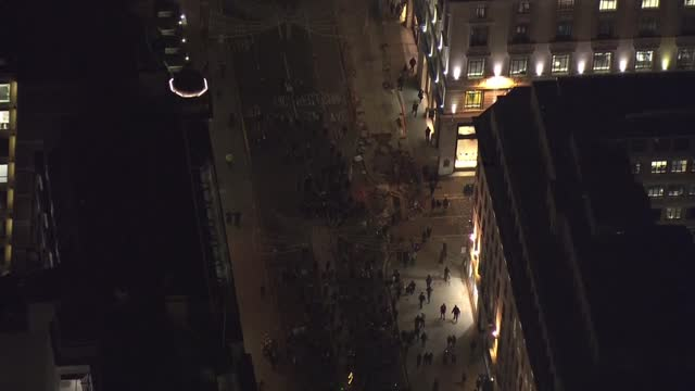 aerials of anti-lockdown protesters in central london; england: london: ext / night further air views - aerials of anti-lockdown protesters marching... - marching stock videos & royalty-free footage