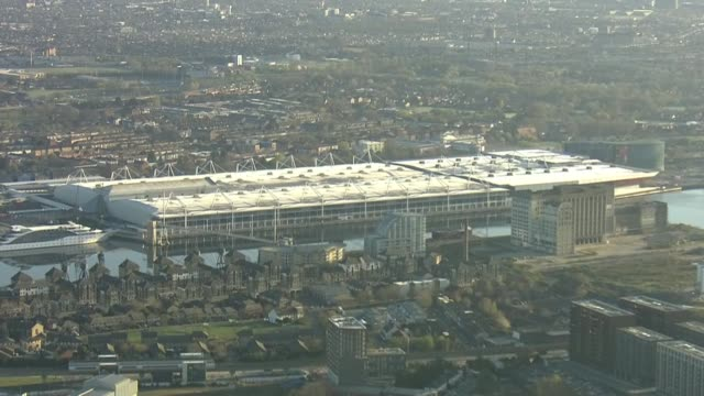 aerials of nhs nightingale; england: london: ext air views south london and docklands and excel centre as temporary hospital under construction and... - london docklands stock videos & royalty-free footage