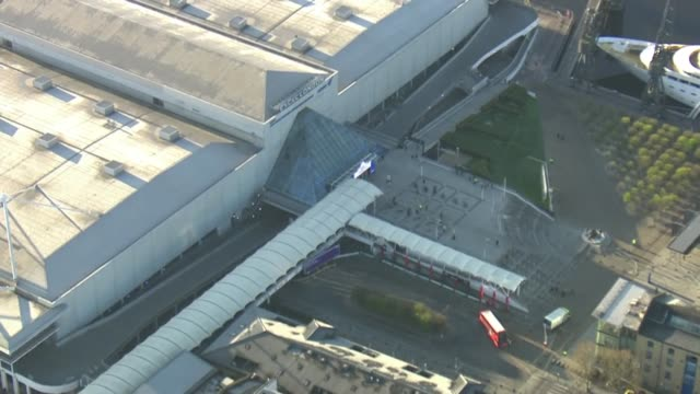aerials of nhs nightingale; england: london: ext air views excel centre and surrounding area during construction of nhs nightingale london and sign... - sun roof stock videos & royalty-free footage