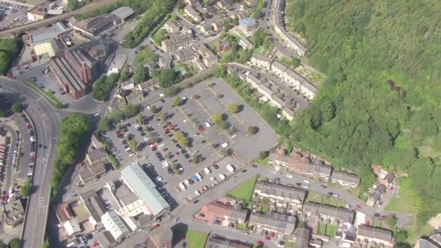 aerials of testing sites in manchester, west yorkshire and merseyside; england: greater manchester: rochdale: town hall car park: ext air views /... - pool hall stock videos & royalty-free footage