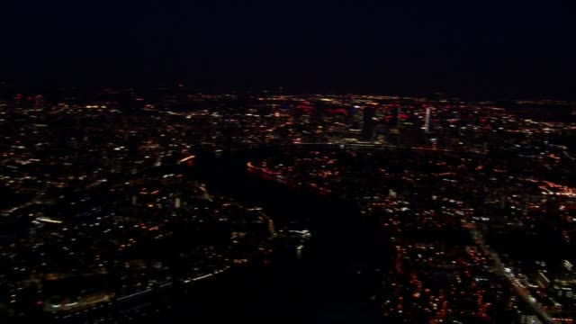 air views of a quiet london england london top of the shard illuminated blue / skyscrapers of docklands and canary wharf - office block exterior stock videos & royalty-free footage