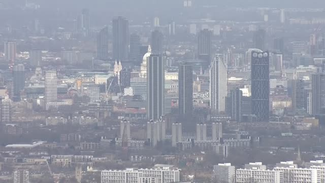 air views of an empty london england london view over houses and industrial parks ans view towards the skyscrapers of the city of london and st... - office block exterior stock videos & royalty-free footage