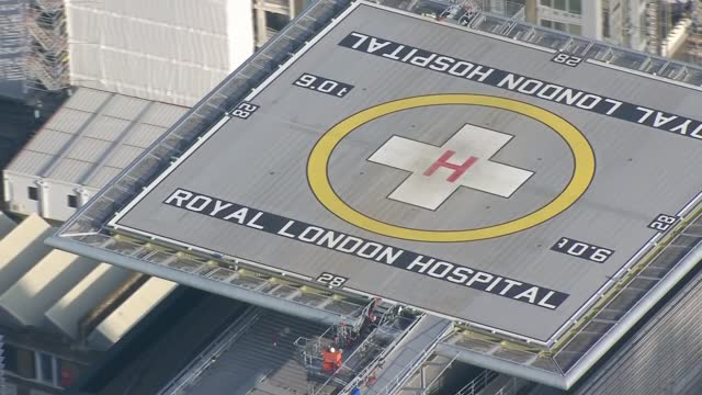 air views of east london hospitals; england: london: ext air views / aerials ambulance along road and arriving at king george hospital in ilford with... - ilford stock videos & royalty-free footage