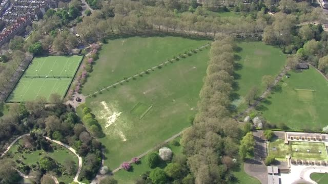 air views of london parks during lockdown; england: london: battersea park: ext air view various of people exercising, sunbathing and playing in park - battersea park stock videos & royalty-free footage