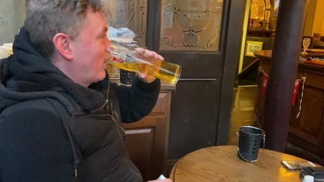 all restaurants, pubs and leisure outlets ordered to close / measures announced to pay workers' wages; england: int man drinking pint of beer in pub... - working stock videos & royalty-free footage