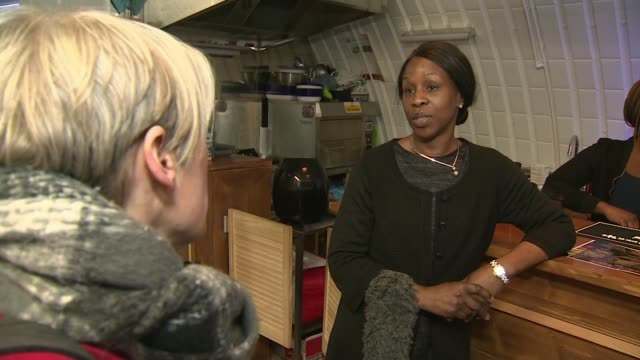 all restaurants, pubs and leisure outlets ordered to close / measures announced to pay workers' wages; england: london: brixton: ext woman putting up... - buying stock videos & royalty-free footage