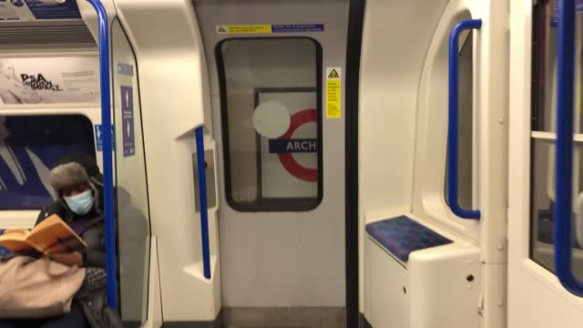 almost empty tube commute through london; england: london: int point of view shots into archway tube station, through ticket barriers, down escalator... - on the move stock videos & royalty-free footage