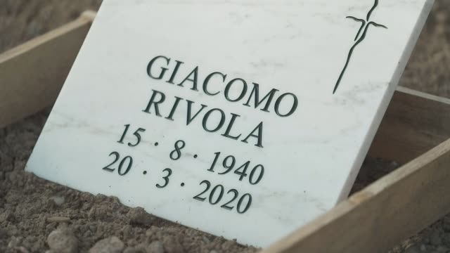 stockvideo's en b-roll-footage met as the country emerges from the covid19 crisis there is anger that lockdown came too late for many italy bergamo air views of city cemetery with... - new not politics
