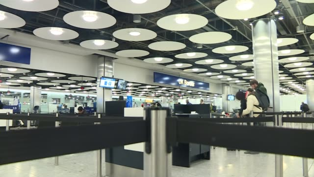 authorities cut all transport links between wuhan and the outside world; england: london: heathrow airport: general view uk border passport control... - control stock videos & royalty-free footage