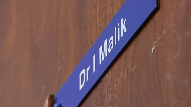 communities disproportionately affecetd by the covid-19 virus; england: nottinghamshire: nottingham: int various of dr irfan malik talking with... - community stock videos & royalty-free footage