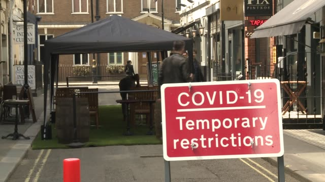 bars and restaurants in soho prepare for second day of reopening; england: london: soho: ext gvs the arts theatre with posters about wearing medical... - cafe stock videos & royalty-free footage