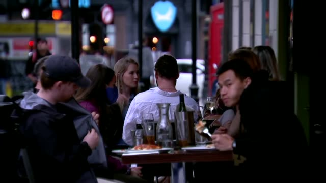 bars reopening in soho; england: london: soho: ext various of crowds of people drinking outside pub 'the spice of life' in closed-off street as... - eating stock videos & royalty-free footage