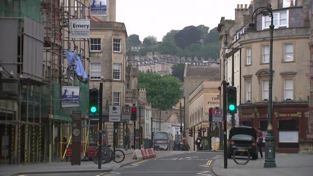 bath gvs; england: somerset: bath: ext union jack flag flying / bath guildhall / 'thank you' nhs flag flying / pulteney bridge over river avon /... - pulteney bridge stock videos & royalty-free footage