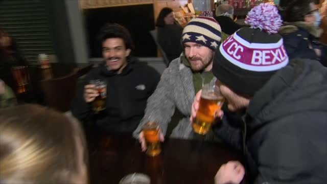 bexleyheath pub reopens at midnight; england: london: bexleyheath: ext / night staff putting tables and chairs outside kentish belle bar int staff... - countdown stock videos & royalty-free footage