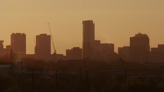 birmingham is the worst hit city outside of london; england: birmingham: ext evening train along as setting sun turns sky orange in background... - midlands occidentali video stock e b–roll