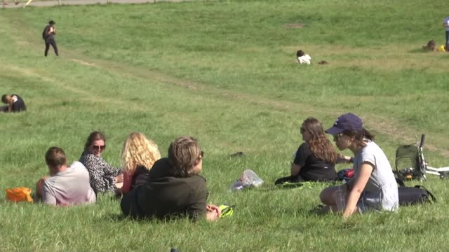 boris johnson announces further relaxation of lockdown rules; england: london: ext groups of people standing atop primrose hill groups sitting on... - relaxation stock videos & royalty-free footage