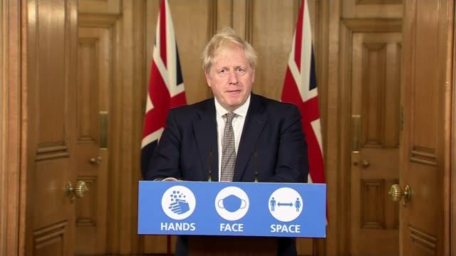 boris johnson announces second nationwide lockdown; england: london: westminster: downing street: int boris johnson mp , chris whitty and sir patrick... - illusion stock videos & royalty-free footage