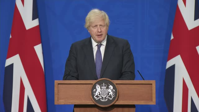 boris johnson confirms lockdown rules to end on july 19th; england: london: downing street: number 9: int boris johnson mp along to podium / press... - number 9 stock videos & royalty-free footage