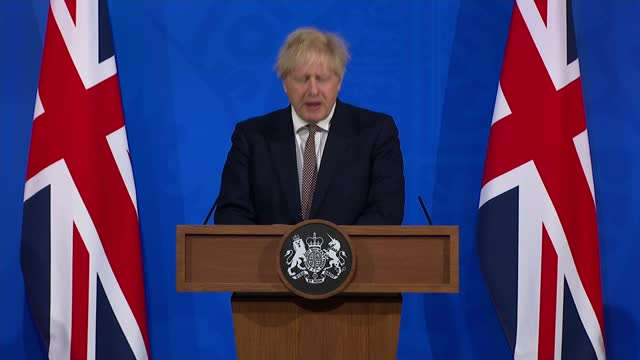 boris johnson confirms next steps for lifting lockdown in england; england: london: westminster: downing street: int boris johnson mp press... - channel 4 news stock videos & royalty-free footage