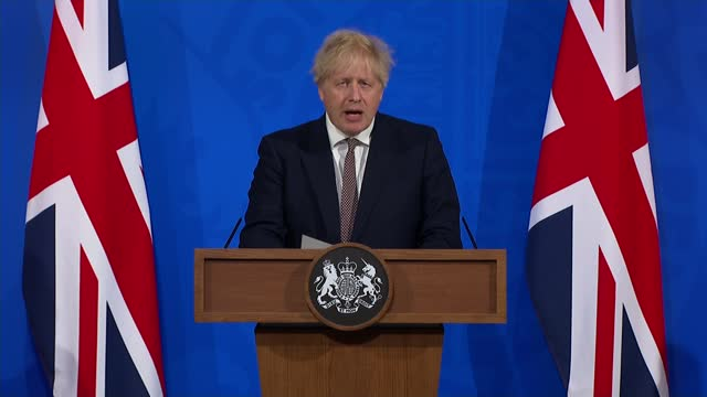 boris johnson confirms next steps for lifting lockdown in england; england: london: westminster: downing street: int cutaway of boris johnson mp... - channel 4 news stock videos & royalty-free footage