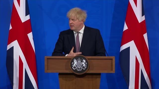 boris johnson confirms next steps for lifting lockdown in england; england: london: westminster: downing street: int boris johnson mp answering... - attitude stock videos & royalty-free footage