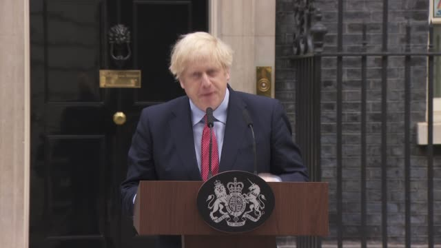 boris johnson downing street statement as returning to work; england: london: downing street: ext boris johnson from number 10 and to press... - beginnings stock videos & royalty-free footage