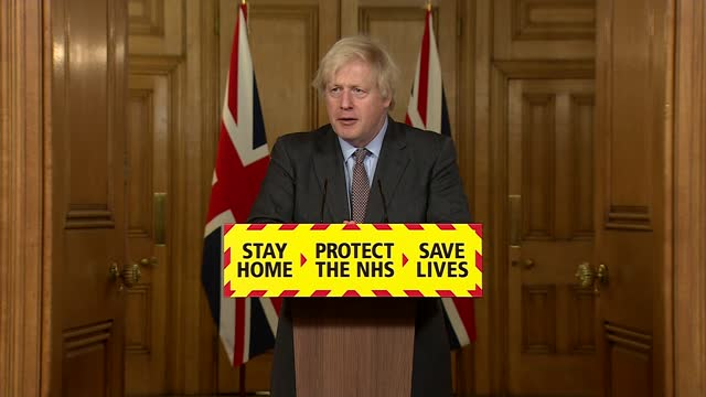 boris johnson hails vaccination effort but warns level of infection is still too high; england: london: westminster: 10 downing street: int boris... - cutaway video transition stock videos & royalty-free footage
