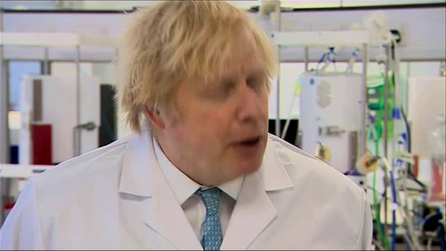 boris johnson optimistic about plans to ease lockdown restrictions in england; england: east yorkshire: hull: int margaret hopkins taking off jacket... - gift stock videos & royalty-free footage