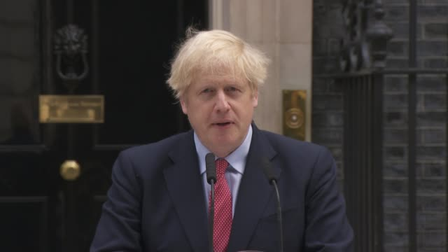 vidéos et rushes de boris johnson returns to work warning that lockdown will continue: reaction in uxbridge; england: london: downing street: ext boris johnson mp press... - invisible