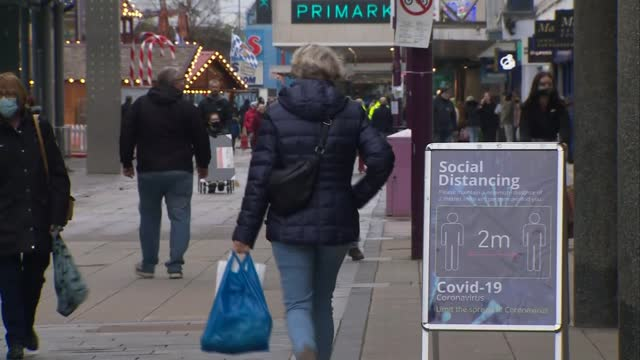 boris johnson says full lockdown can't be ruled out as uk cases surge; england: essex: basildon: ext various shots of people along east walk shopping... - itv london lunchtime news stock videos & royalty-free footage