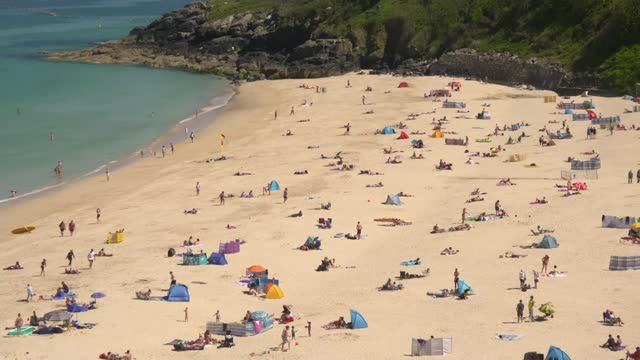 boris johnson says spread of the delta variant a matter of serious concern; england: cornwall: st ives: ext various wide shots people sat on beach - beach stock videos & royalty-free footage