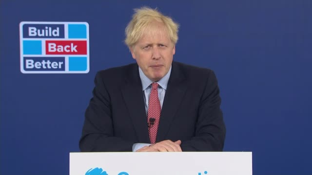 boris johnson sets out his 'new jerusalem' vision for post-covid uk; england: london: int gvs boris johnson mp along into room to podium close shot... - lectern stock videos & royalty-free footage