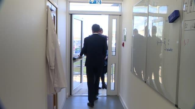 boris johnson visits a laboratory; england: bedfordshire: int boris johnson mp chatting with scientists / johnson shaking hands with scientists and... - boris johnson stock videos & royalty-free footage