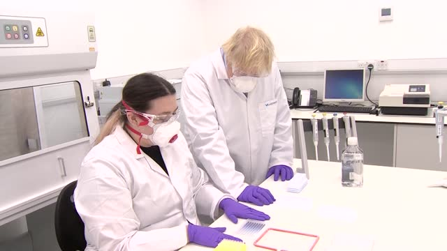 boris johnson visits biotech company in edinburgh; scotland: edinburgh: int boris johnson mp wearing face mask and lab coat in laboratory / scientist... - epidemiology stock videos & royalty-free footage