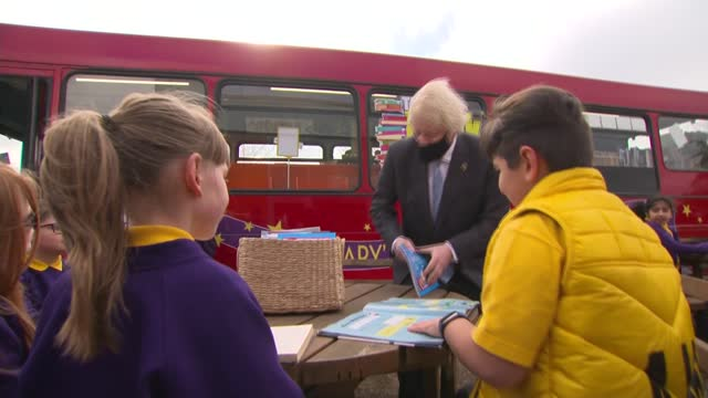 boris johnson visits primary school and interview; england: staffordshire: stoke-on-trent: st mary's primary school: ext boris johnson mp reading... - girls stock videos & royalty-free footage