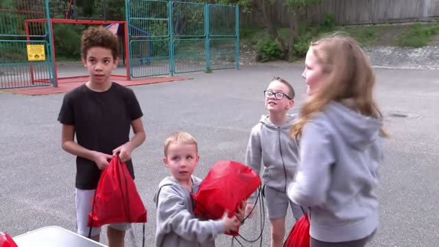 brentford fc deliver activity packs to locals in lockdown england london brentford ext gv ball pull out child running up to ball and kicking it low... - sportswear stock videos & royalty-free footage