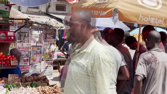 burial of covid-denying former tanzanian president john magufuli; tanzania, zanzibar; ishaq ismail sharif interview, ismail jussa interview, street... - タンザニア点の映像素材/bロール