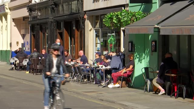 calls for tougher measures in london following implementation of 10pm curfew; england: london: leicester square: ext people sat out on deckchairs in... - outdoor chair stock videos & royalty-free footage