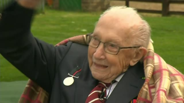 captain tom moore celebrates 100th birthday england bedfordshire ext captain tom moore seated in garden spitfire and hurricane wwiiera planes flypast... - captain tom moore stock videos & royalty-free footage