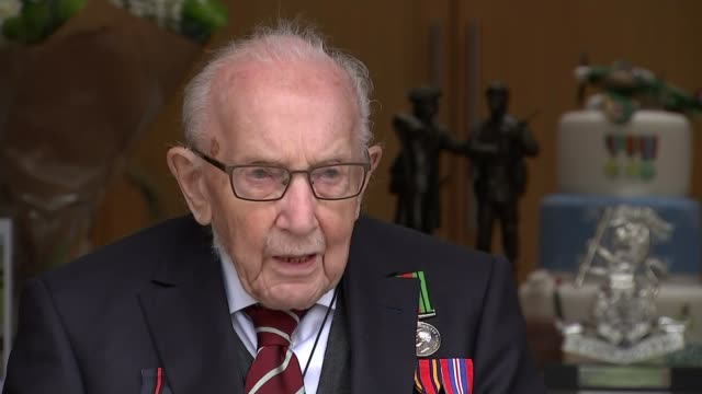 captain tom moore celebrates 100th birthday england bedfordshire ext captain tom moore interview sot never anticipated raising nearly 30 million... - captain tom moore stock videos & royalty-free footage