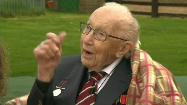 captain tom moore celebrates 100th birthday england bedfordshire captain tom moore seated in garden spitfire and hurricane wwiiera planes flypast in... - captain tom moore stock videos & royalty-free footage